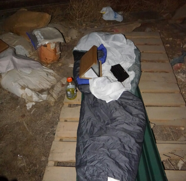 sleeping bag on pallets