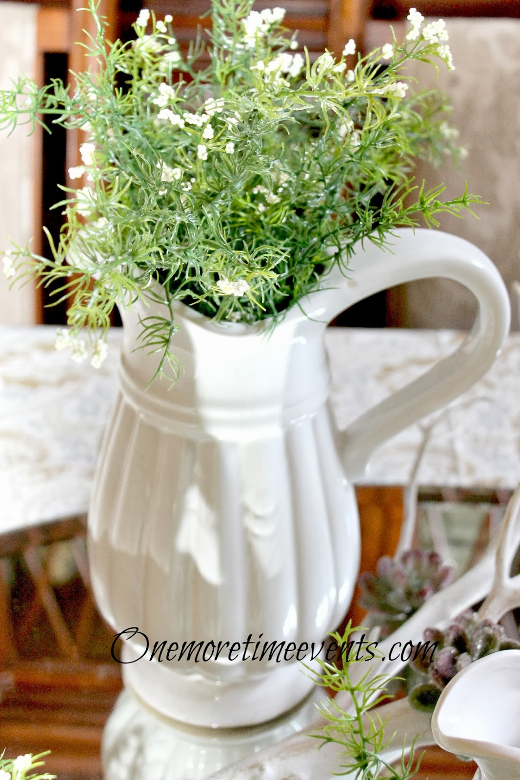 Large white Pitcher filled with greenery at One More Time Events.com