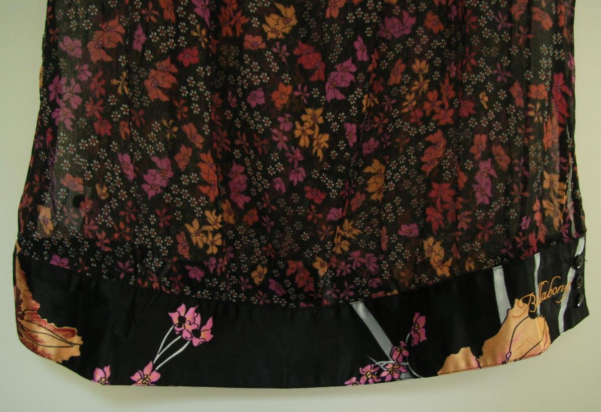 marque pas cher dans vide dressing de Flora : BILLABONG - chemisier noir fleuri