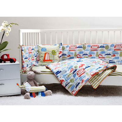 Ella & Otto Beep Beep Nursery Bedding. Shows our delightful transport inspired design on a cot.