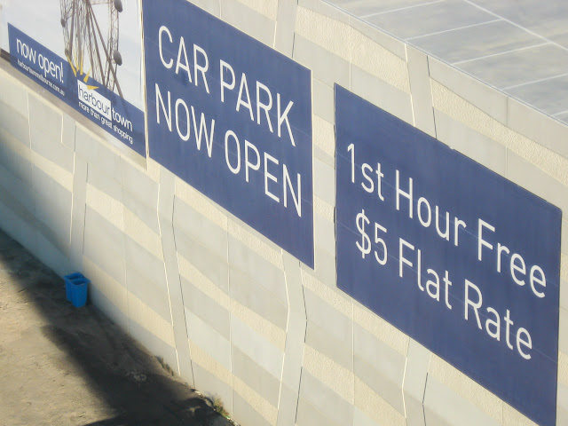 cheap parking sign in the docklands