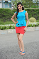 Rcha Panai in Red mini Skirt and Blue Tank Top Spicy Photos