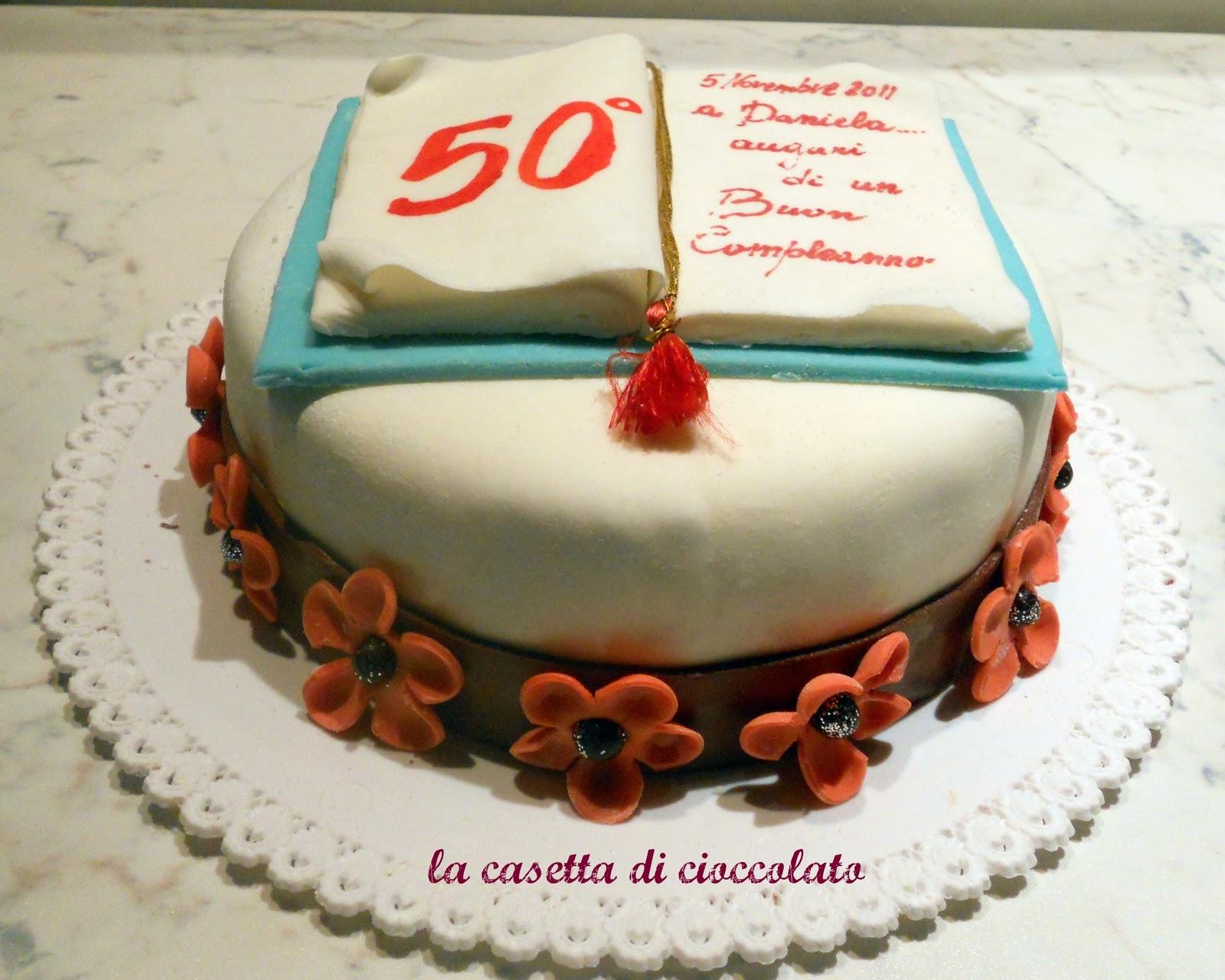Preferenza la casetta di cioccolato: torta con il libro aperto per Daniela IP02