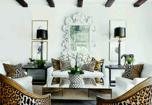 white living room with leopard print chair gold mirror accents