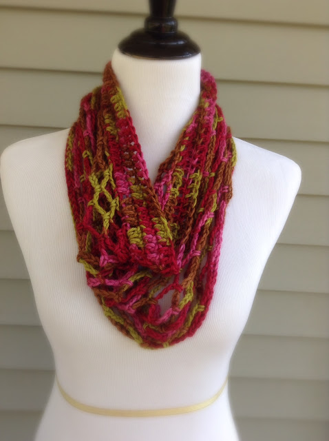 http://www.ravelry.com/patterns/library/tardiness-of-spring-cowl