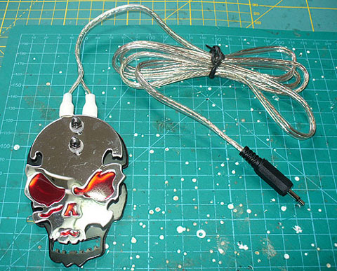 DIY Solderless Assistive Technology foot pedal for switch adapted/accessible equipment. Image of an adapted Skull Tattoo foot pedal.