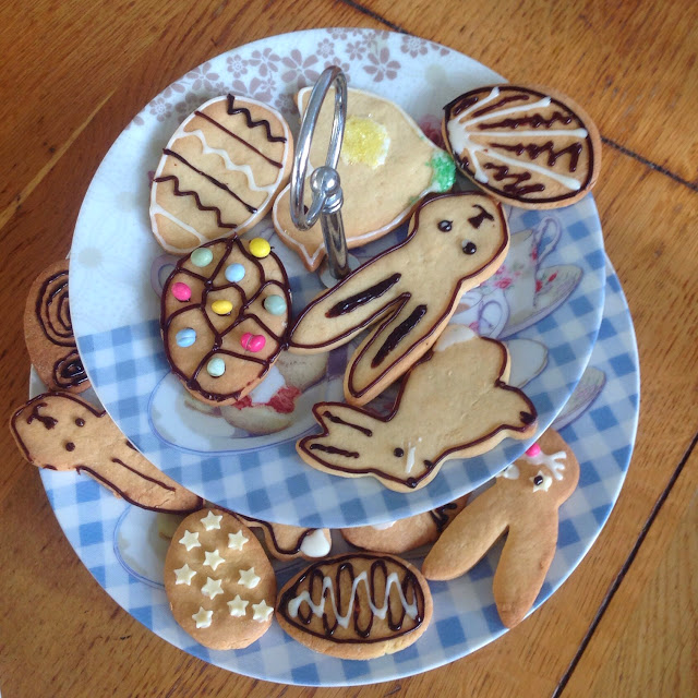 making biscuits plate of easter themed decorated cookies