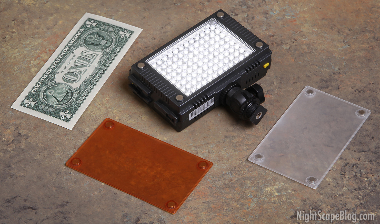 the z96 led video light panel is very compact it come with a screwon adjustable mounting headbracket and two magnetic snapon filters dollar bill not