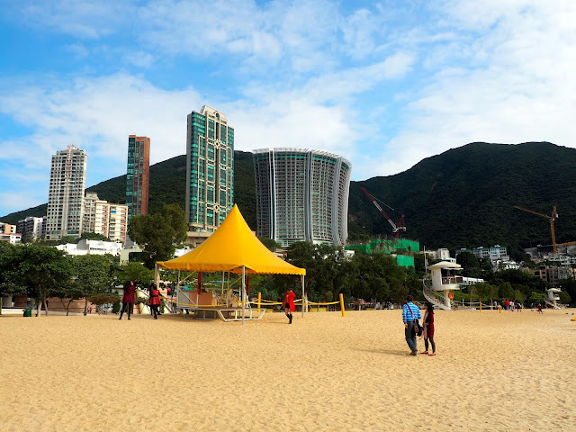 The hills and buildings beyond the sand of Repulse Bay Beach, Hong Kong