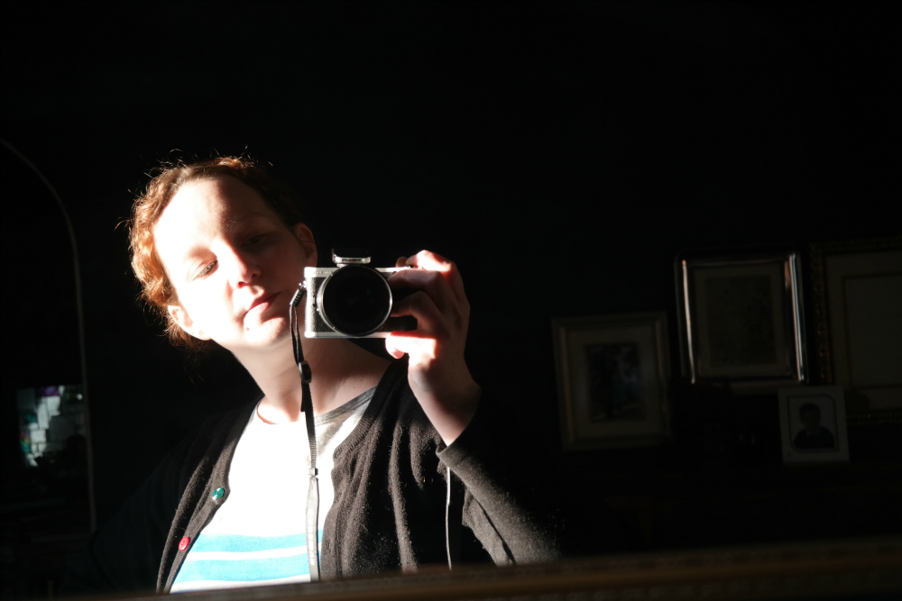Self-portrait, low sun, dark background