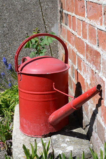 Hausstylish blog red watering can