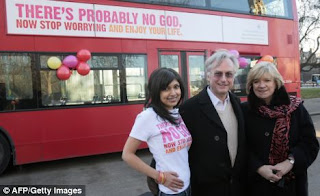 Ariane Sherine, Richard Dawkins and Polly Toynbee in front of a London bus displaying the atheist advertising campaign