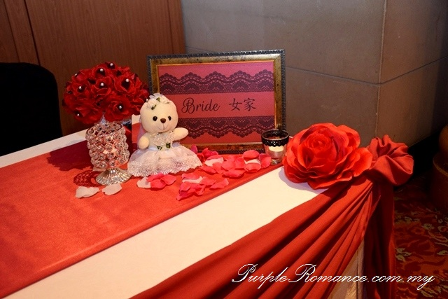 Red Black Lace Wedding Decoration at Renaissance Hotel Kuala Lumpur, petals, floating candle, walkway, aisle, flower stand, floral, red roses, ballroom, selangor, malaysia, elegant, vibrant, special, unique, wedding day, VIP table centerpiece, block candle, posie, chair tie back, maroon, entrance flower arch, reception table decoration, teddy bear, crystal candle light holder, bride side, groom side, table runner, tea candle, red roses with pearl, maroon satin fabric scallop, design, draping
