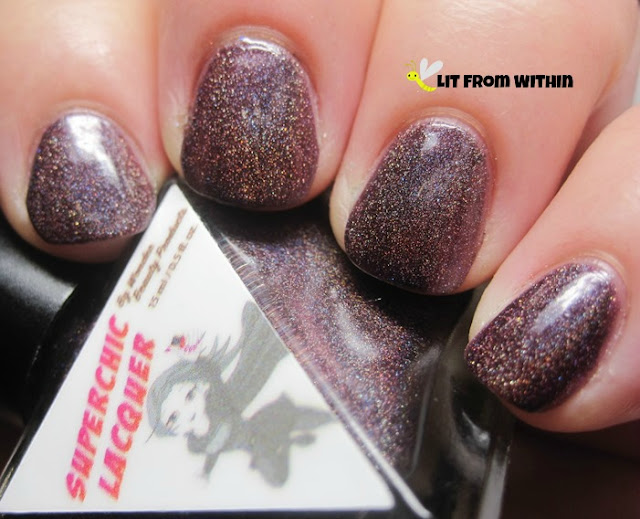 Euphoria is a deep, rich plum holo
