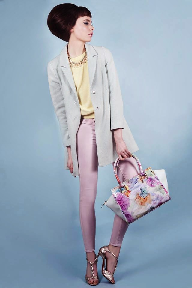 Sophie wears pretty pastels with bouffant hair and pretty pastel makeup