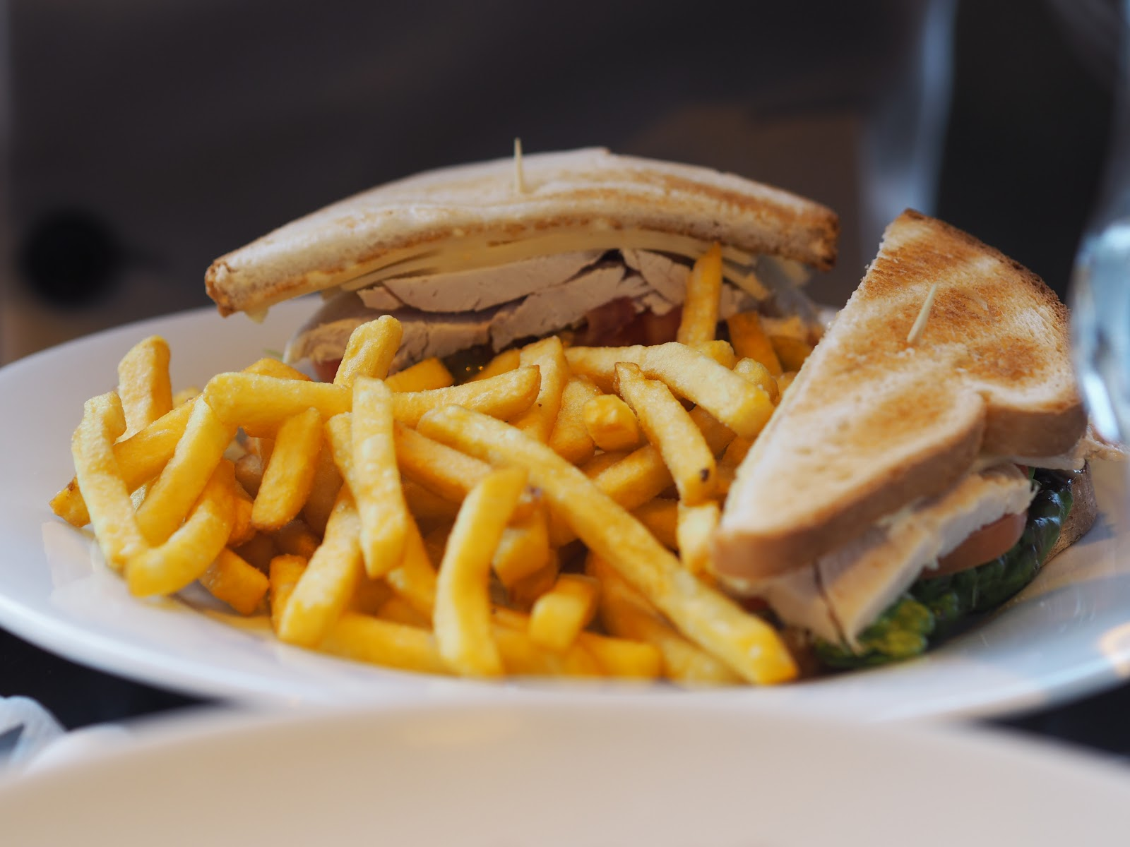 Plate of Club Sandwich and chips