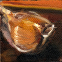 Very small oil painting of a clove of garlic.