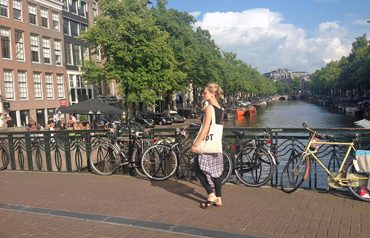 Hanging out in Amsterdam, crossing the canal, Euro trip, summer style, Asos denim, Suburban Riot tote, H&M cork slides