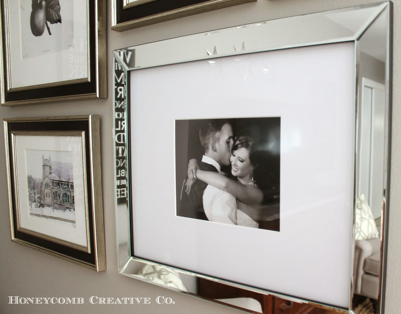 and one of my favorite images from our wedding looks gorgeous in this mirrored frame