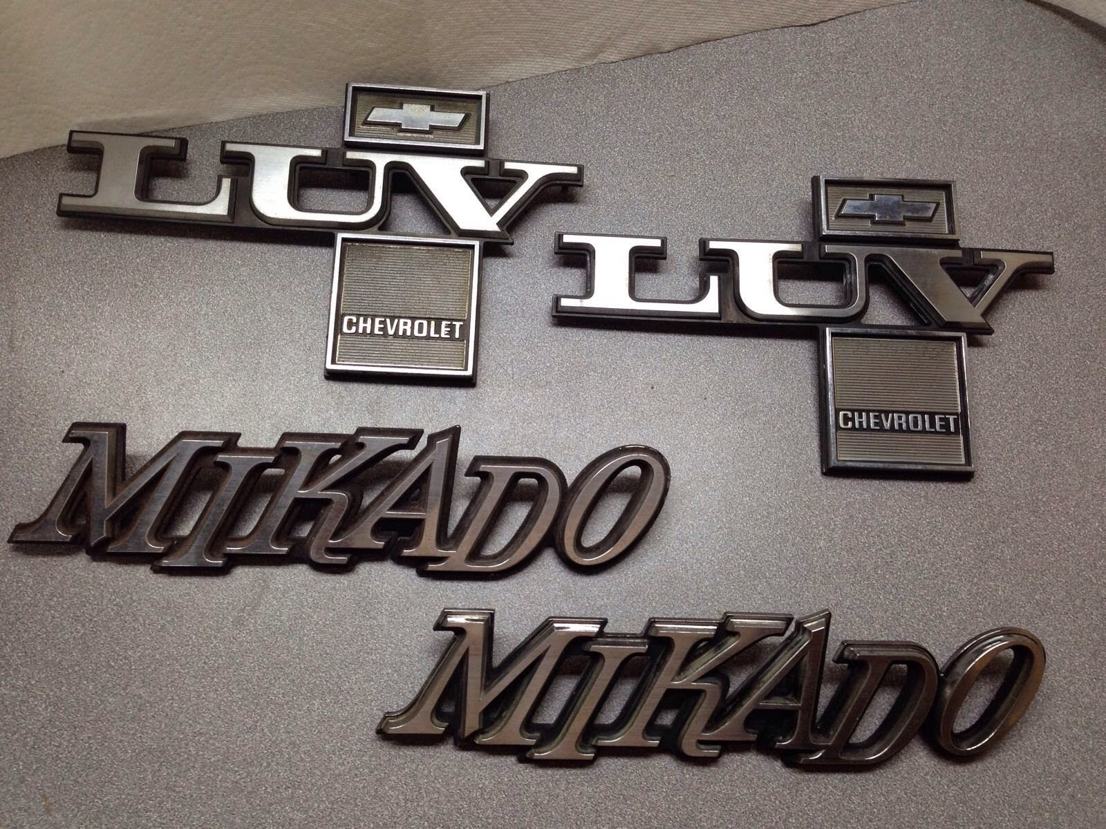"""Chevy LUV Emblems 1979-1980 Pair Of Fender """"Luv"""" And """"Mikado"""" Bed Pair OEM Nice"""