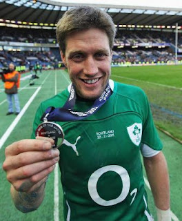 Ronan O'Gara celebrates with his Man of the Match medal after the Scotland vs. Ireland Six Nations match in 2011.