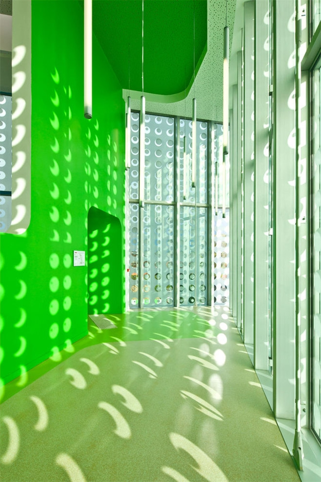 Photo of green painted hallway next to the windows