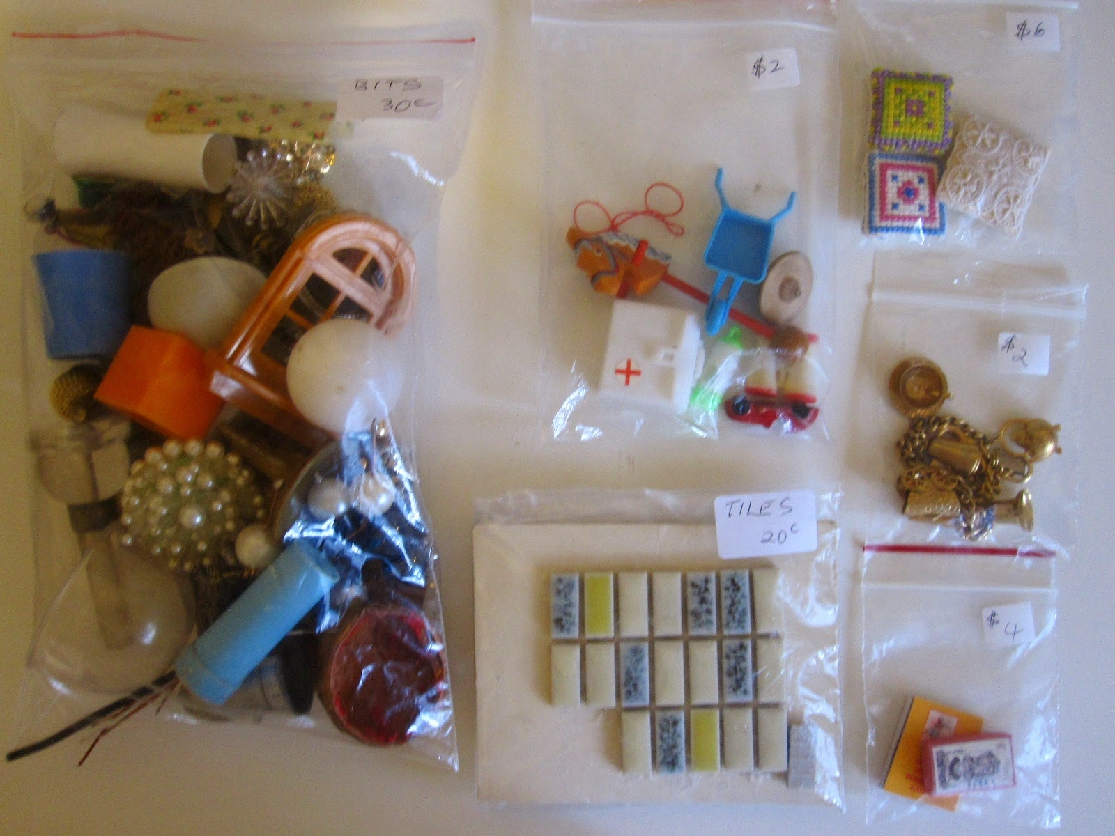Six bags of vintage dolls house miniatures and various bits that could be used in miniature