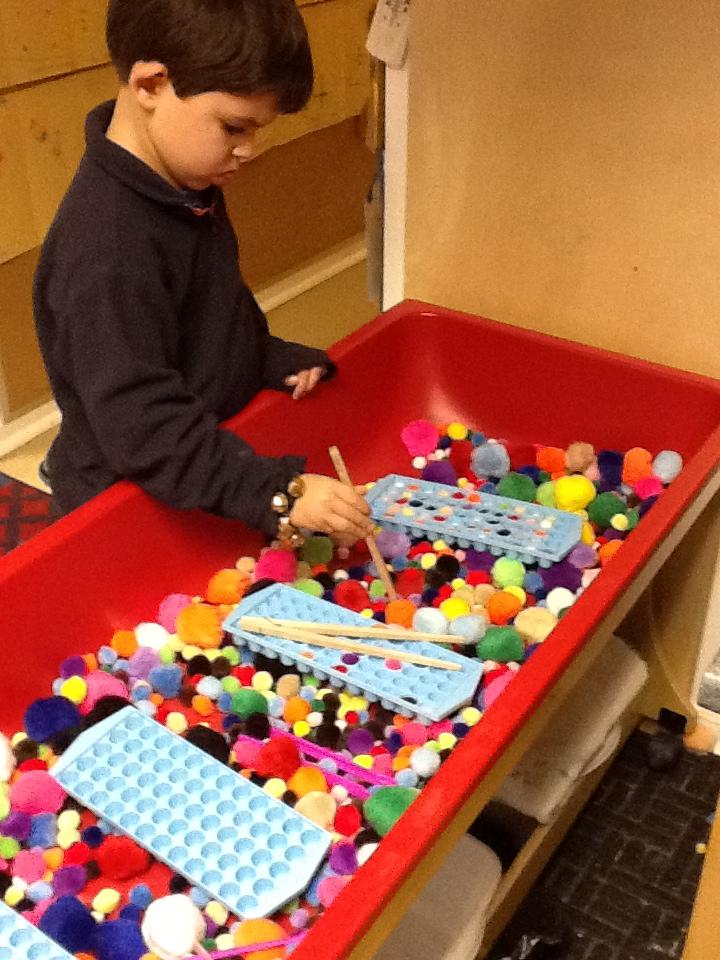 Playfully Learning Sensory Table Idea Pom Poms