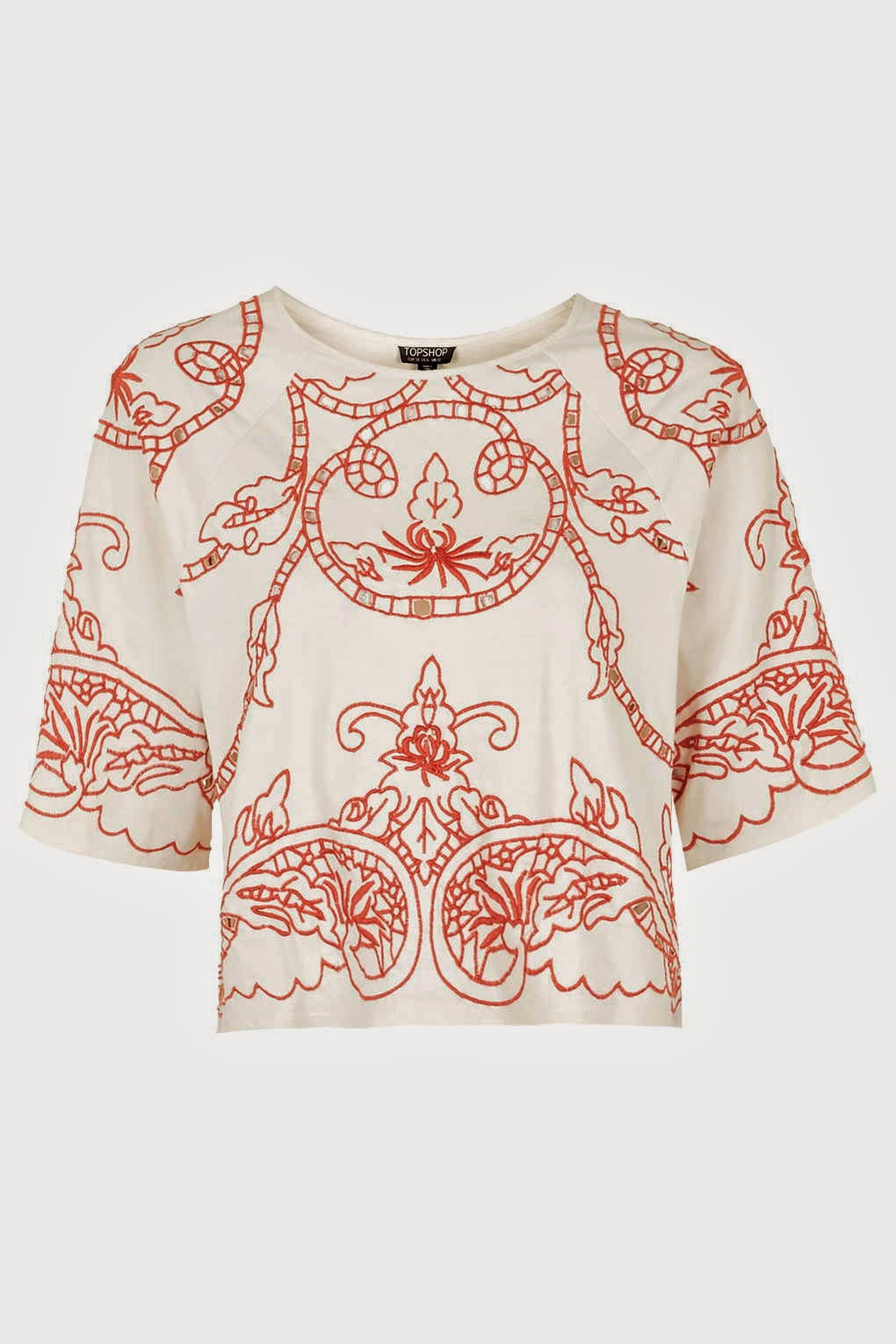 white top red embroidered pattern