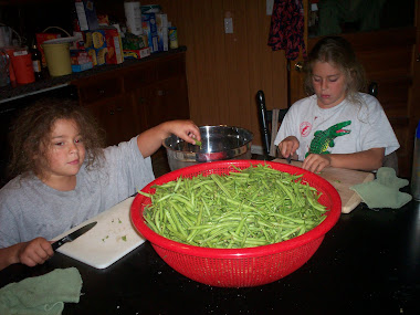 Girls helping with green beans.
