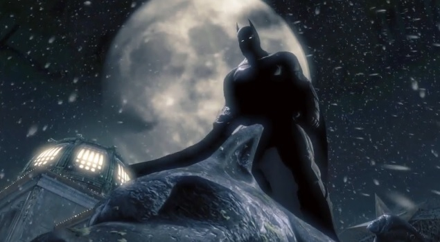 Batman standing on a building in Gotham City with the moon in the background. Image from the E3 2013 trailer for the video game Batman: Arkham Origins.