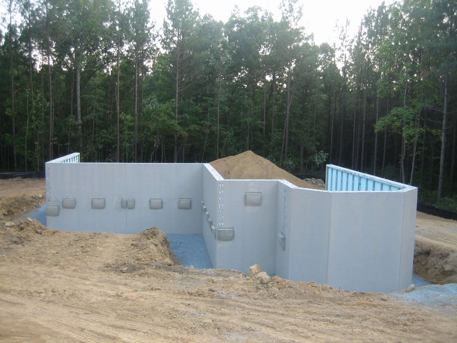 Our new home the basement walls are here part 1 for Prefab basement walls