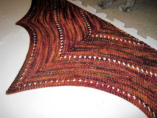 http://www.ravelry.com/projects/morninglorie/the-age-of-brass-and-steam-kerchief