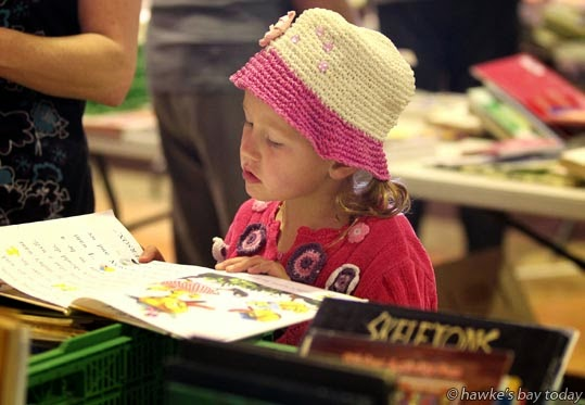Lucy Simmons, 5, Havelock North - 26th Mammoth Book Sale, run by Hastings Host Lions Club, at the Hawke's Bay Showgrounds, Hastings photograph