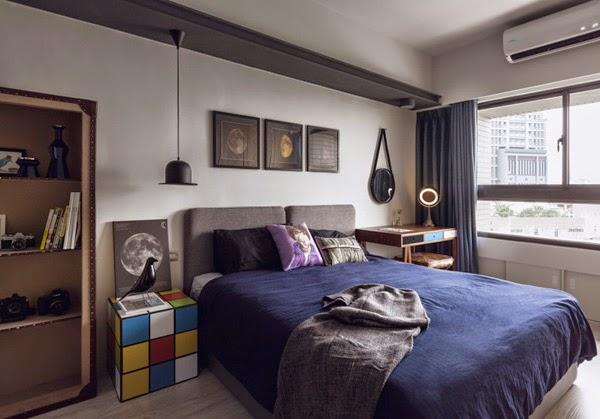 dormitorio con lámpara de techo bombín y mesita o mesilla de noche cubo rubik