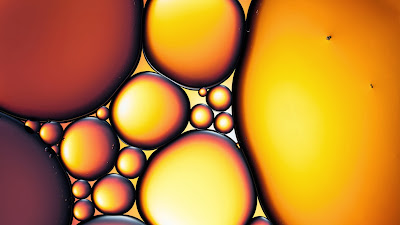 Oil and water abstract symbolizing the sacred oil of Hanukkah tradition (© Thomas Vogel/Getty Images) 443