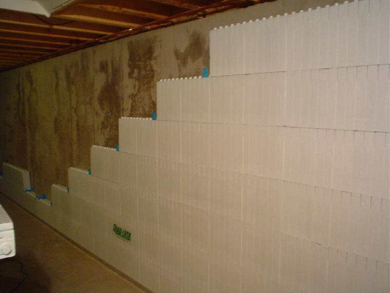 basement wall panels after coating the interior concrete wall or
