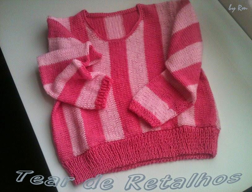 Casaco infantil de tricô, listrado de rosa, parecido com a roupa da órfã Edith do filme Meu Malvado Preferido.