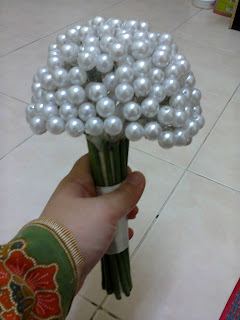 white pearl hand bouquet