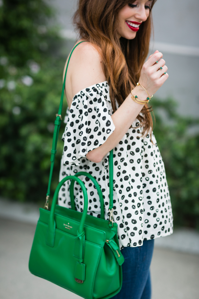 black and white polka dot off-the-shoulder top with flared jeans M Loves M @marmar