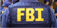 An agent's back with FBI on his jacket