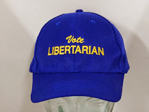 Royal blue and says Vote Libertarian