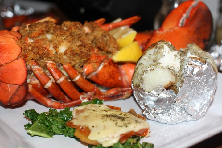 Stuffed baked lobster with baked potato and sour cream,