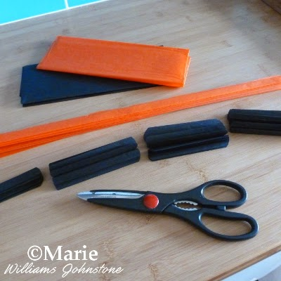 Black and orange tissue papers folded up and cut to size