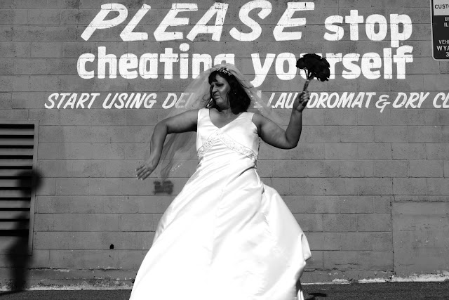 An angry bride who's about to throw her bouquet of flowers onto the ground.