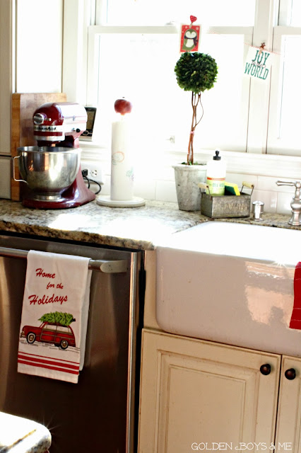Red kitchen aid stand mixer and farmhouse sink at Christmas-www.goldenboysandme.com