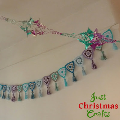 Crocheted bunting garland with pretty tassels