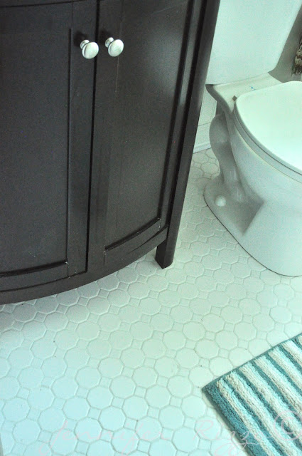 The Oak house project full bathroom renovation with penny floor tiles