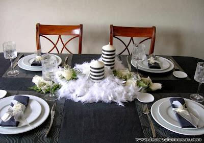decoracion mesas blanco y negro con plumas