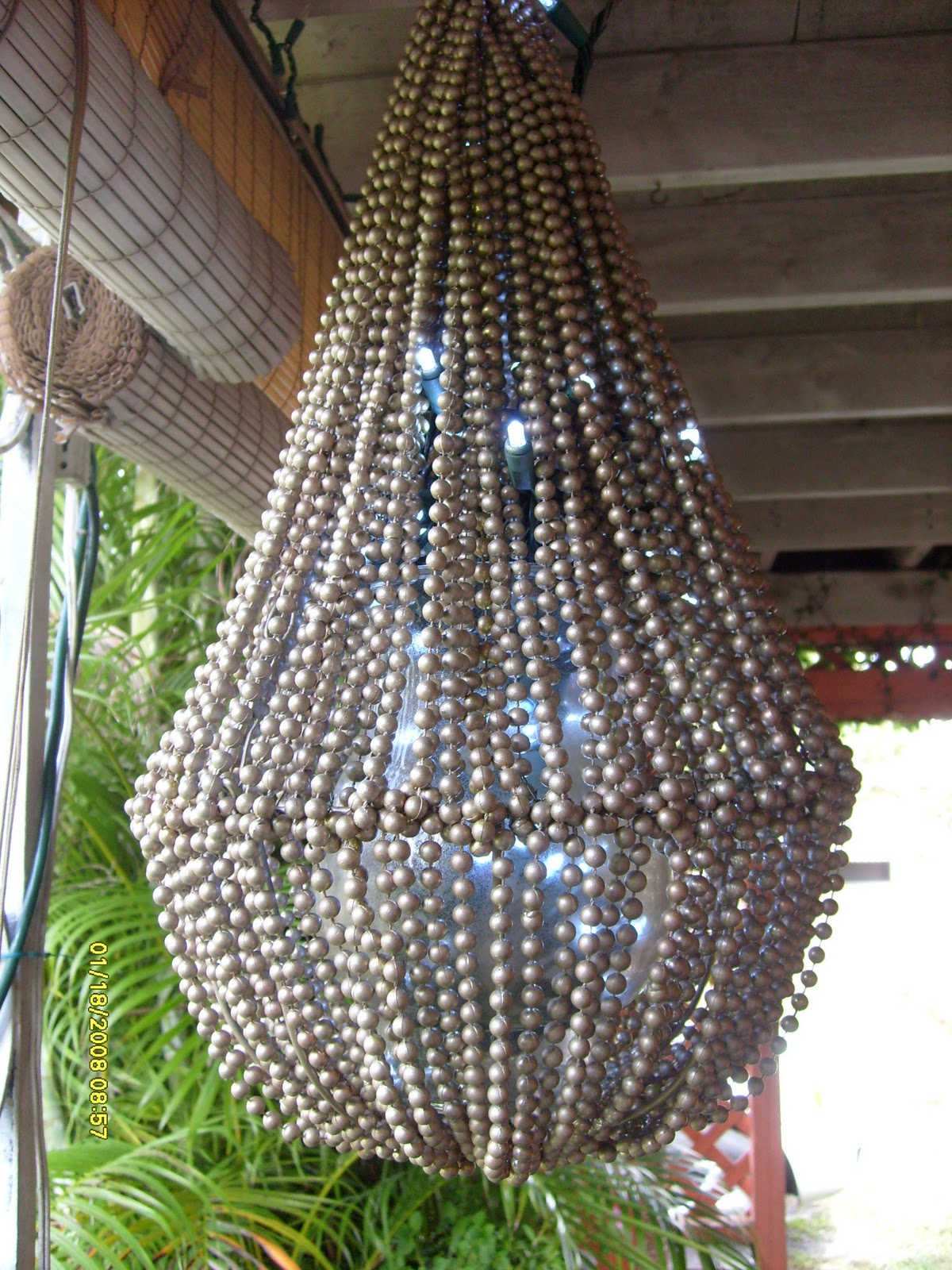 The beaded chandelier in the daylight. You can barely make out the  title=